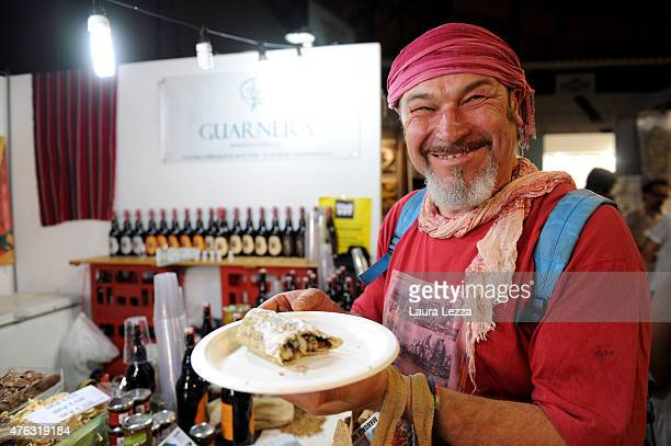 A man eats a piadina made with hemp during the third edition of Indica Sativa Trade on June 7 2015 in Bologna Italy In the Italian exhibition...