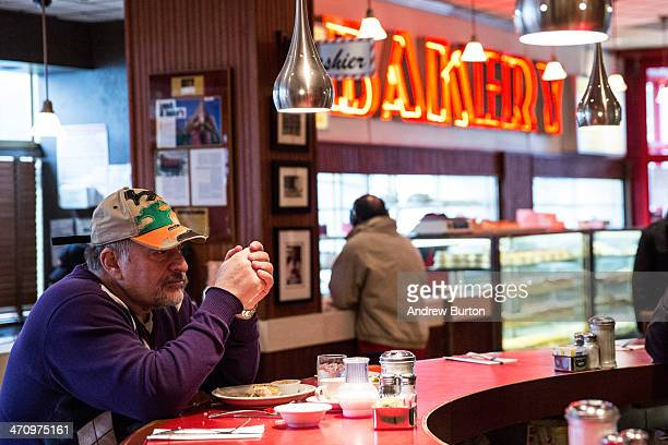 A man eats at the bar of Junior's restaurant a staple of Brooklyn dining since the 1950s on February 21 2014 in the Downtown Brooklyn neighborhood of...