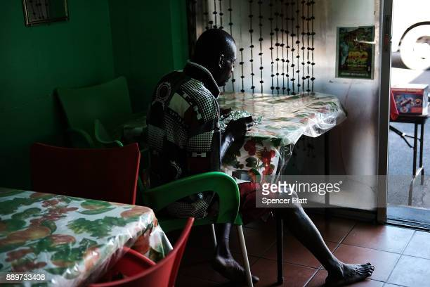 A man eats in a restaurant on December 10 2017 in St John's Antiqua While it's sister island Barbuda was nearly destroyed by Hurricane Irma Antiqua...