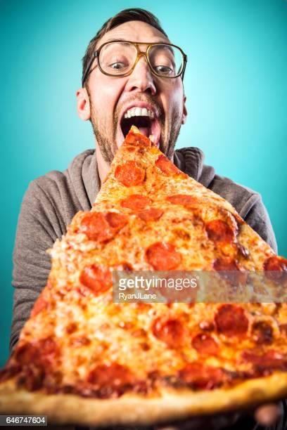 Man Eats Oversized Pizza Slice