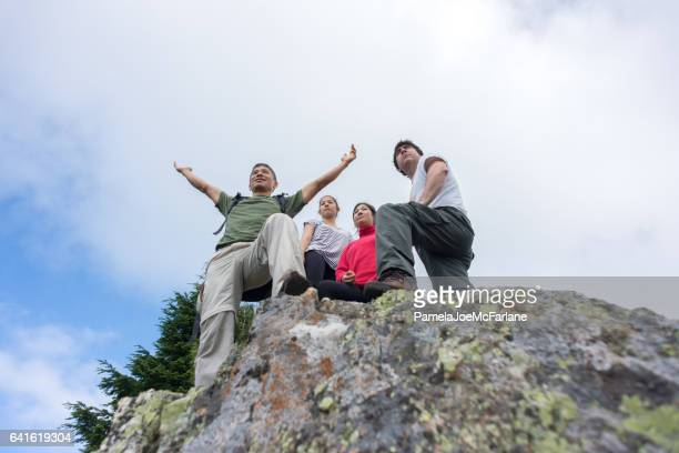 Man Embracing Nature with Open Arms Enjoying View with Familiy