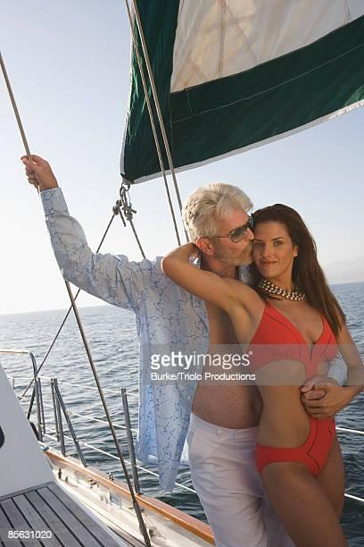 Man embracing woman in bikini