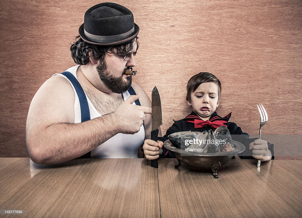 Man Encourages Young Sailor Boy to Eat Raw Fish Heads