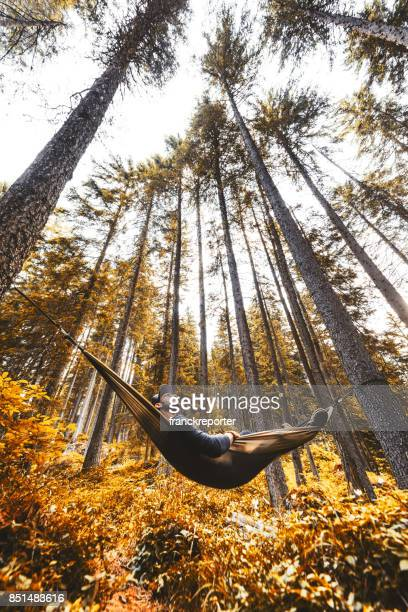 man enjoy in the hammock in autumn