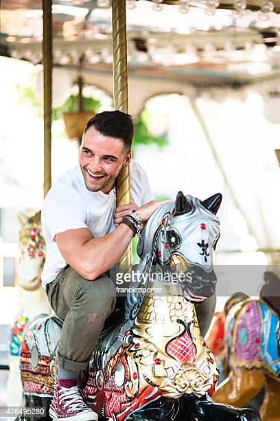 man enjoy on the carousel