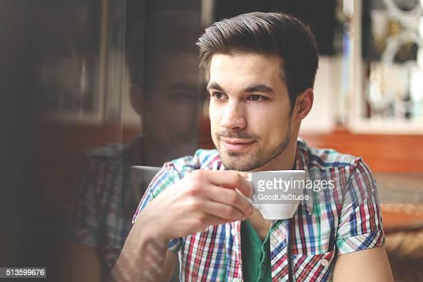 Man enjoying a cup of coffee