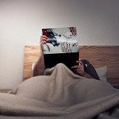 man enjoying a porn magazine