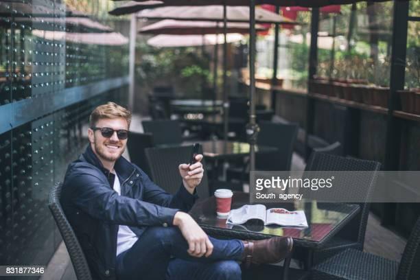 Man enjoying alone in cafe