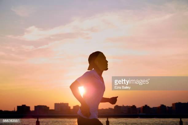 Man enjoying an early morning jog in the city.