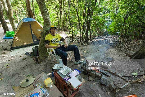 Man enjoying camp cooking
