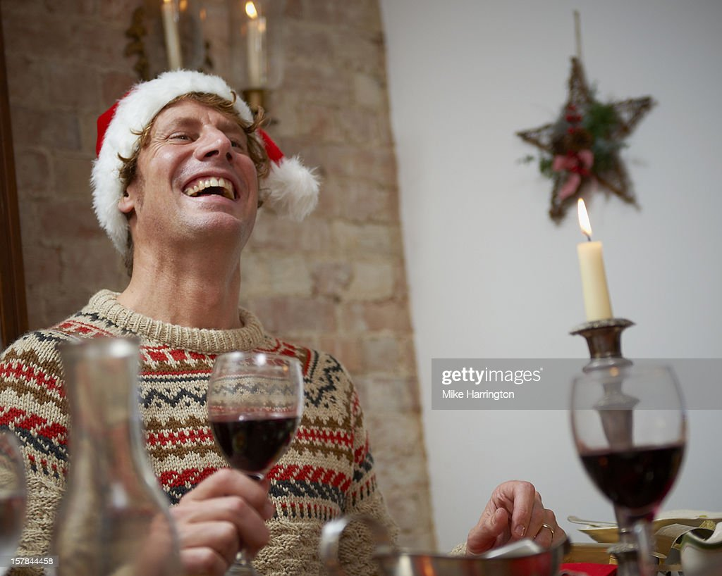 Man enjoying Christmas dinner. : Stock Photo