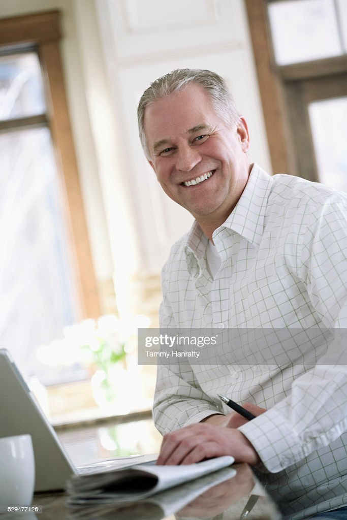 Man enjoying his morning news and coffee : Stock Photo