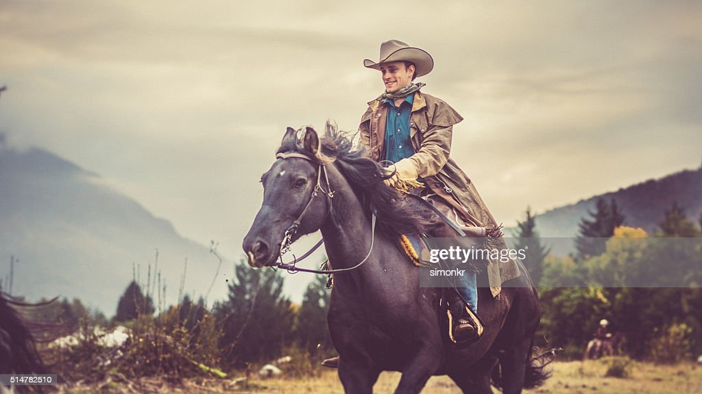 Man enjoying horse riding : Stock Photo