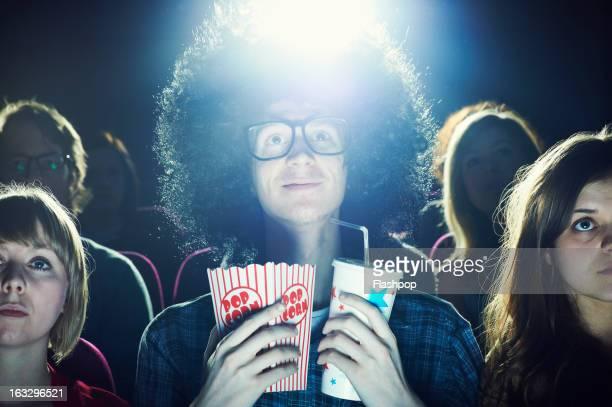 Man enjoying movie at cinema