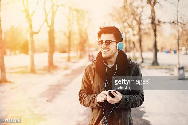 Man enjoying the music at the park
