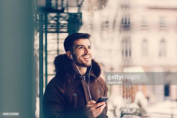 Man enjoying the music in the city