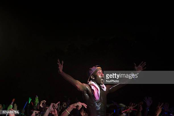A man enjoying the night event on the festival Holi color festival that was held in East Park Bung Karno Sport Center held for young people to have...