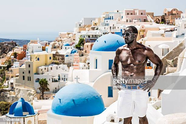 Man enjoying vacations in Oia village, Santorini island