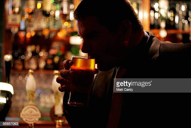 A man enjoys a drink in the Harrington Club a traditional gentlemans club in Bath on October 15 2005 in Bath England Pubs and clubs prepare for the...