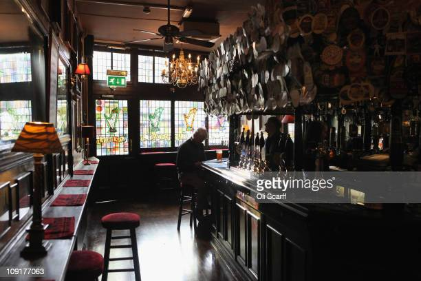 A man enjoys a pint of bitter in The Harp pub on the day it was named as the Campaign for Real Ale's national pub of the year on February 16 2011 in...