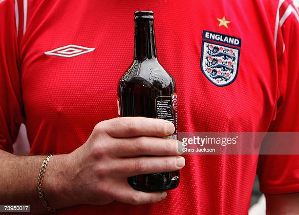 A man enjoys an early morning beer during the Capital Radio St Georges Day Recording at Ye Old St Georges Pub in Beckenham on April 23 2007 in London...