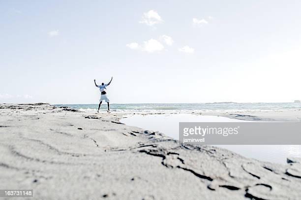 man enjoys beach while exercising