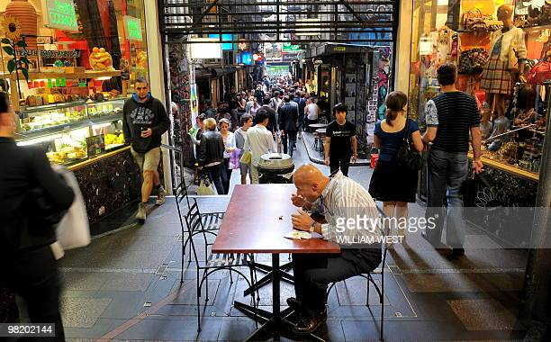 A man enjoys his lunch in one of Melbourne's innercity laneways which is home to many vibrant bars cafes restaurants boutiques sushi bars and shops...