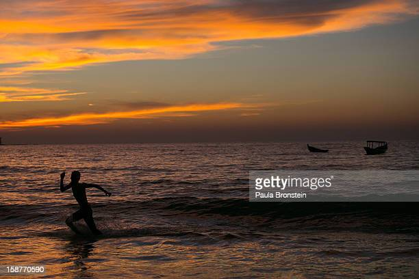 A man enjoys the ocean after sunset November 28 2012 on Ngapali beach Myanmar Myanmar possesses great tourist potential and the country's tourism...