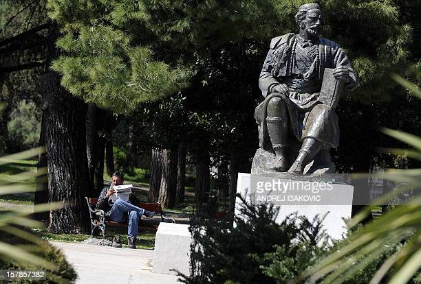A man enjoys the sun at a park beside the monument of Petar Petrovic Njegos a Montenegrin ruler who transformed Montenegro from a theocracy into a...