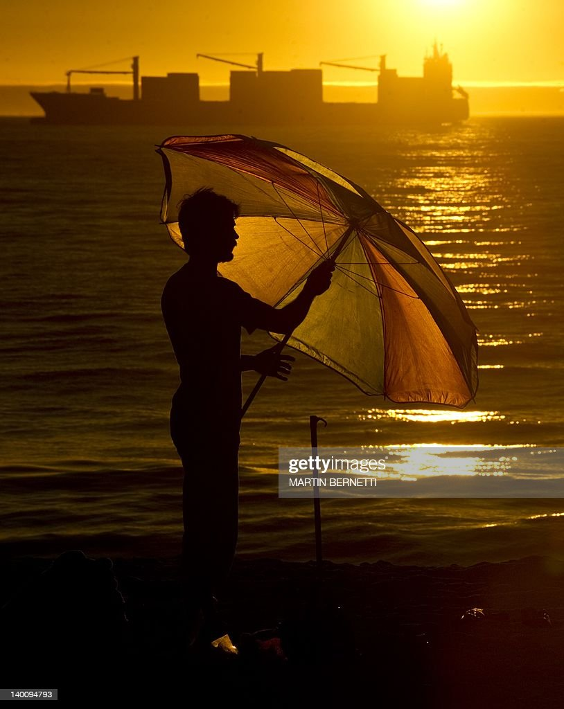 A man enjoys the sunset, on the Bay of Valparaiso in Viña del Mar, Chile, on February 27, 2012.