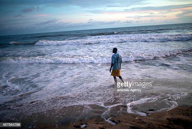 A man enjoys the sunset on the Golden Beach in the Liberian capital of Monrovia on October 20 2014