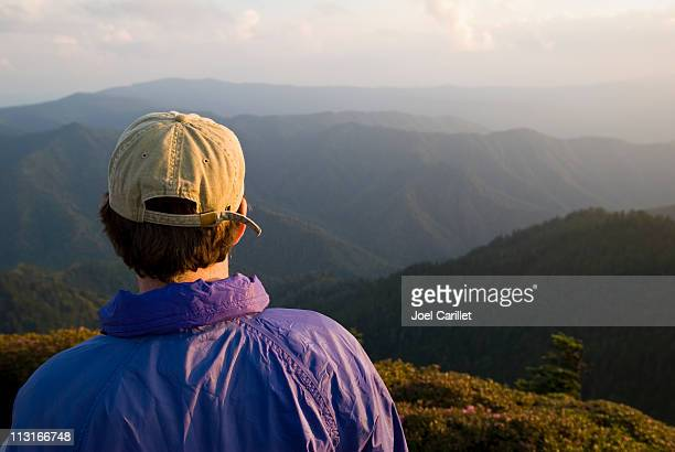 Man with aspirations looking at mountains