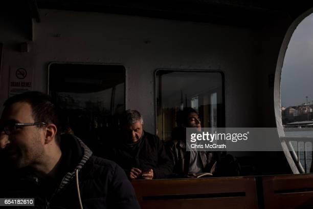 A man enjoys the sunshine on a ferry to Kadikoy on March 16 2017 in Istanbul Turkey Turkey will hold its constitutional referendum on April 16 2017...