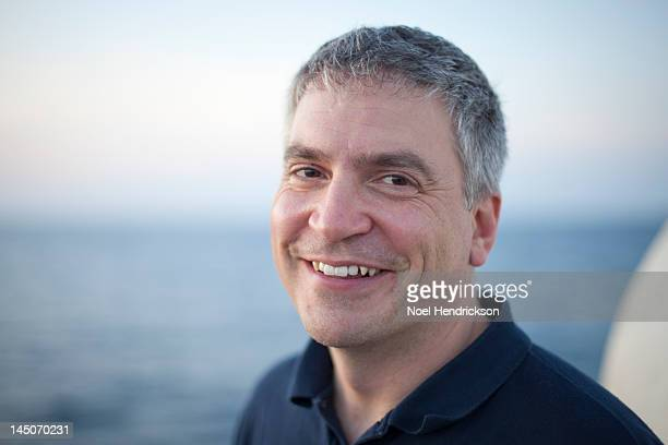A man enjoys views of the ocean from a boat deck