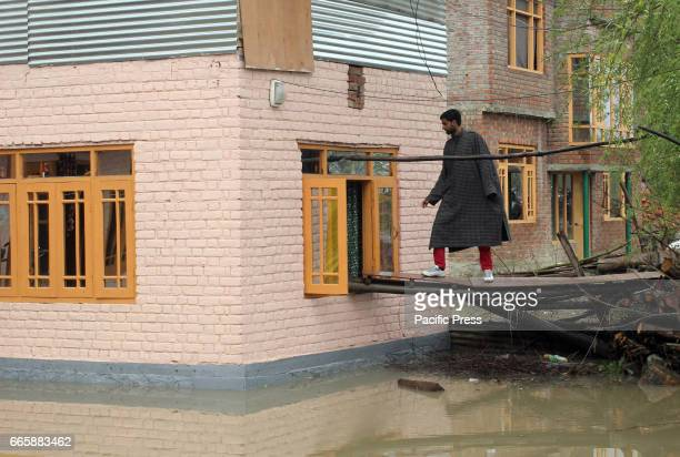 A man enter from window of the house as most of the residential structures are inundated due to heavy rainfall Srinagar Indiancontrolled Kashmir...