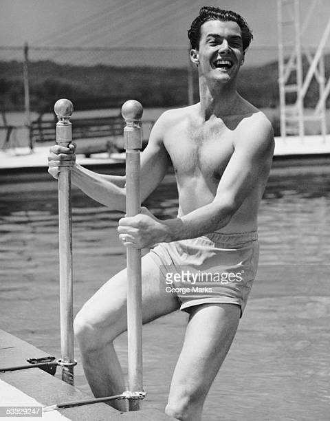 Man entering swimming pool