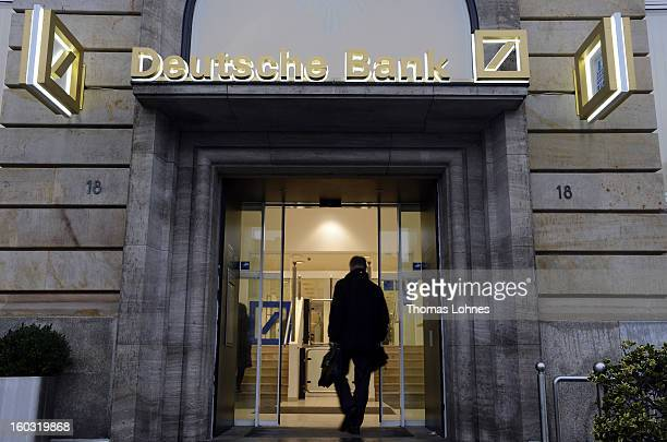 A man enters a branch of the Deutsche Bank on January 29 2013 in Frankfurt am Main Germany The annual results press conference for 2012 takes place...
