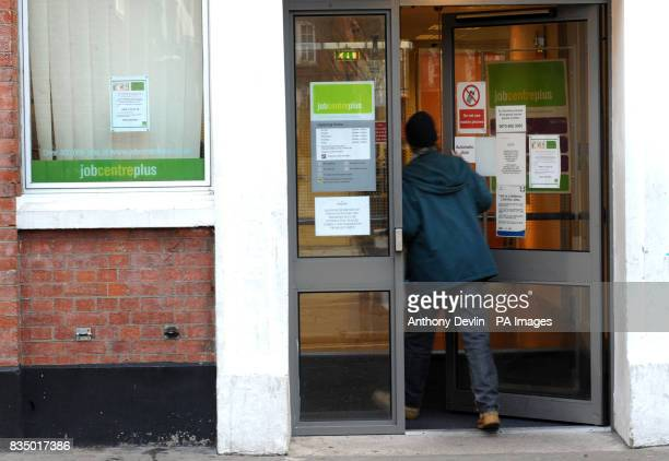 A man enters a Job Centre Plus in Westminster London as record numbers of people are being made redundant and job vacancies are falling as...