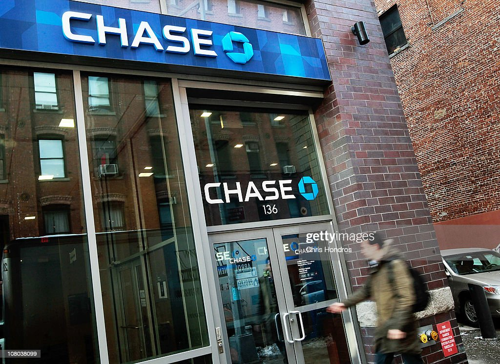 A man enters a JP Morgan Chase branch bank January 14 2011 in New York City JPMorgan Chase one of the nation's largest banks reported $48 billion in...