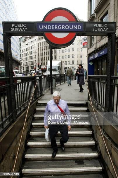 A man enters a subway at Monument Underground station in central London