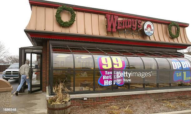 A man enters a Wendy's restaurant December 13 2002 in Des Plaines Illinois Owner Diageo PLC the world's largest liquor company has finalized the sale...