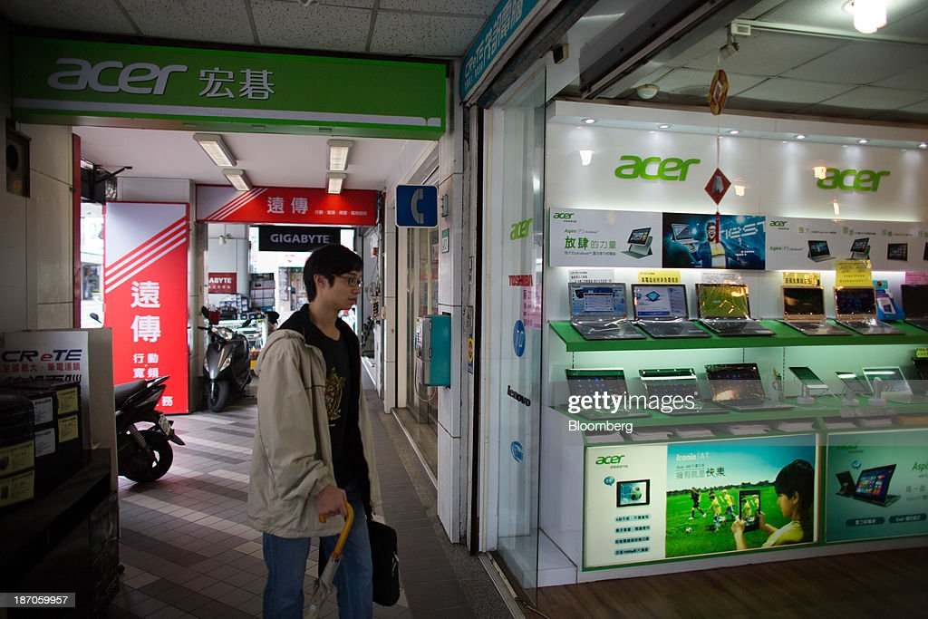 A man enters an electronics store selling Acer Inc. products on Bade Road in Taipei, Taiwan, on Wednesday, Nov. 6, 2013. Acer, Taiwans second-largest computer maker, plunged to a 12-year low in Taipei trading after announcing a record loss, job cuts and the resignation of J.T. Wang as chief executive officer. Photographer: Lam Yik Fei/Bloomberg via Getty Images