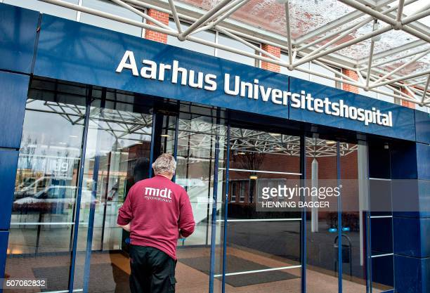 A man enters on January 27 2016 the Aarhus University hospital in Aarhus Denmark where a Danish tourist was tested positive to zika virus after a...