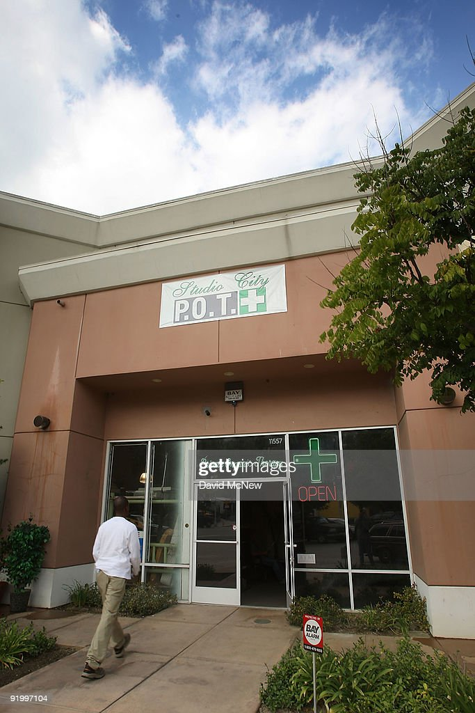 A man enters Private Organic Therapy (P.O.T.), a non-profit co-operative medical marijuana dispensary, on October 19, 2009 in Los Angeles, California. Attorney General Eric Holder announced new guidelines today for federal prosecutors in states where the use of marijuana for medicinal purposes is allowed under state law. Federal prosecutors will no longer trump the state with raids on the southern California dispensaries as they had been doing, but Los Angeles County District Attorney Steve Cooley recently began a crackdown campaign that will include raids against the facilities. Cooley maintains that virtually all marijuana dispensaries are in violation of the law because they profit from their product. The city of LA has been slow to come to agreement on how to regulate its 800 to 1,000 dispensaries. Californians voted to allow sick people with referrals from doctors to consume cannabis with the passage of state ballot Proposition 215 in 1996 and a total of 14 states now allow the medicinal use of marijuana.