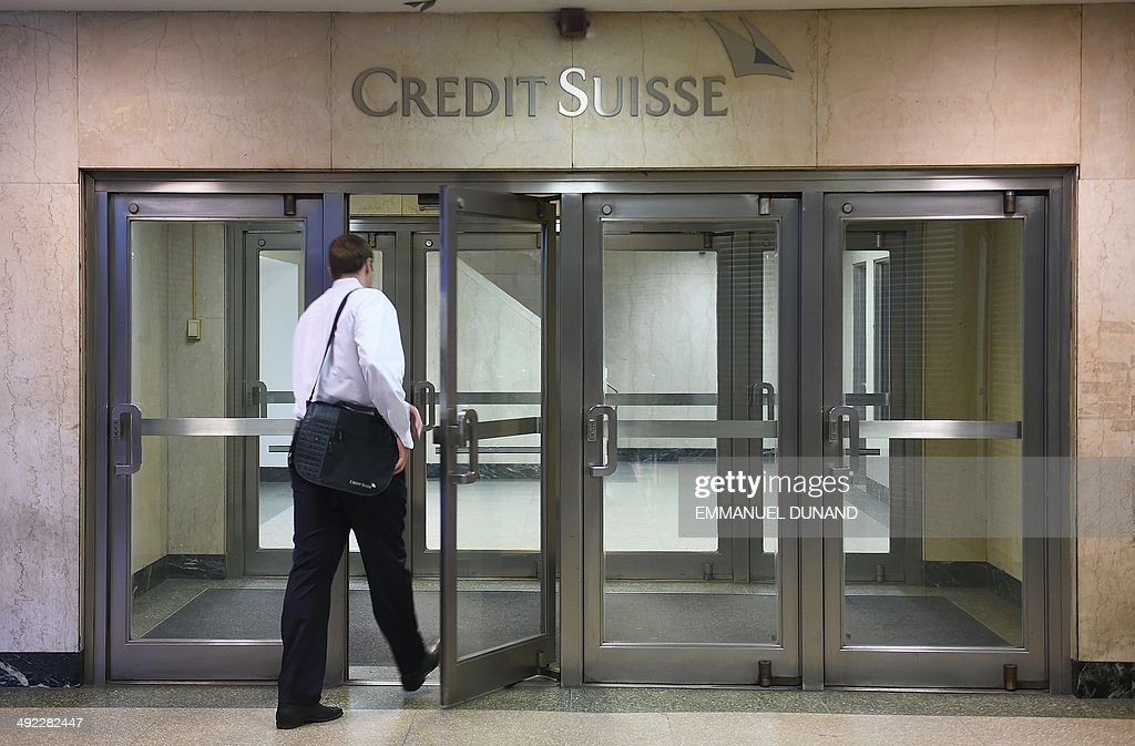 A man enters Swiss bank Credit Suisse headquarters in New York May 19 2014 Credit Suisse Switzerlands secondlargest bank is poised later today to...