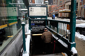 A man enters the 50th street subway station after subway service returned on January 27 2015 in New York City New York was spared the brunt of Winter...