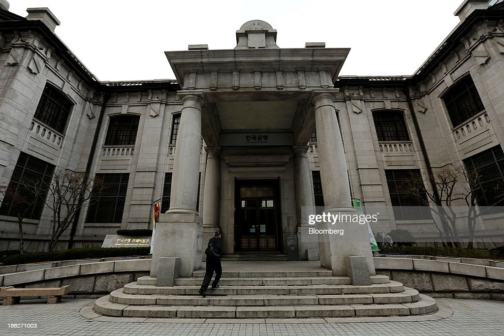 A man enters the Bank of Korea museum at the central bank's headquarters in Seoul, South Korea, on Thursday, April 11, 2013. The Bank of Korea held borrowing costs unchanged for a sixth month, resisting pressure from the government for a reduction even as a sliding yen hurts the nation's exporters and North Korea threatens war. Photographer: SeongJoon Cho/Bloomberg via Getty Images