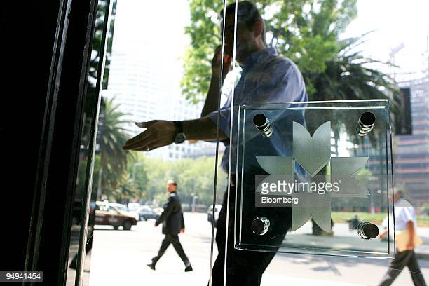 A man enters the building which houses the Mexican Stock Exchange or Bolsa Mexicana de Valores in Mexico City Mexico on Wednesday May 20 2009 Mexican...