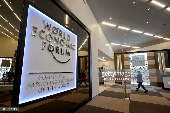 A man enters the Congress Center in Davos on January 20 2015 on the eve of the World Economic Forum annual meeting World leaders including France's...