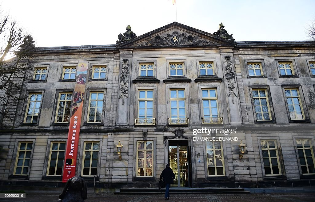 A man enters the Noordbrabants Museum to visit the 'Hieronymus Bosch, Visions of a Genius' exhibition during a press preview at the Noordbrabants Museum in 'Den Bosch on February 11, 2016. To mark the 500th anniversary of Dutch painter Hieronymus Bosch's death, a small museum in his hometown has managed to bring most of the last 25 known surviving paintings by the man dubbed 'the devil's painter' for a major exhibition of his work scheduled from February 13 to May 8, 2016. / AFP / EMMANUEL DUNAND